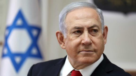 Israeli Prime Minister Benjamin Netanyahu chairs the weekly cabinet meeting at his office in Jerusalem on October 27.