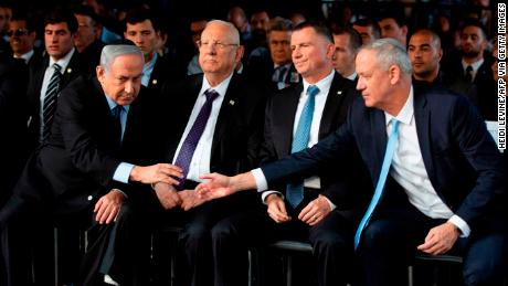 Benny Gantz (right) shakes hands with Prime Minister Benjamin Netanyahu as they attend a state memorial ceremony for former Israeli prime minister Yitzhak Rabin in Jerusalem on November 10, 2019.