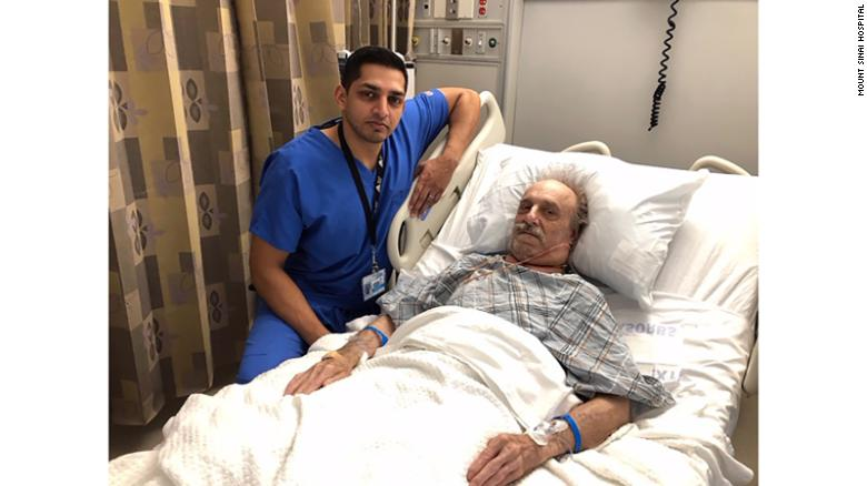 Dr. Nazir Khan and Milton Winger post for a photo after surgery.