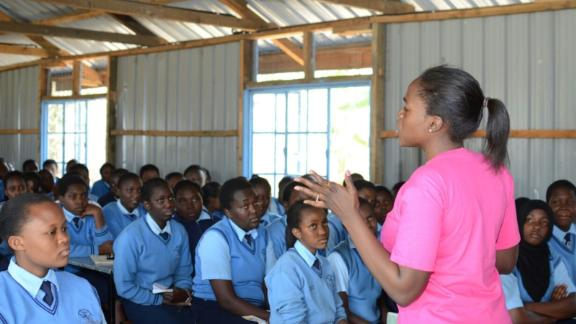 WEX Africa visits schools and talks to girls about science and technology.