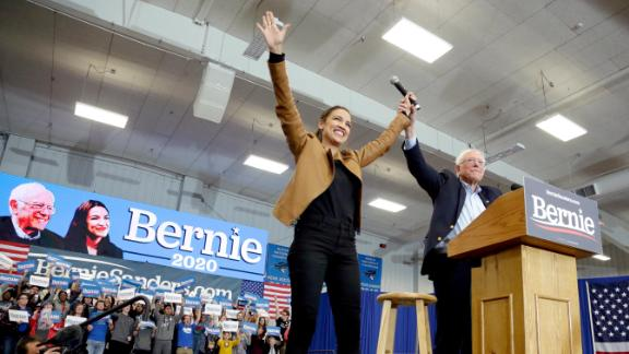 Democratic presidential candidate Sen. Bernie Sanders, I-Vt., and Rep. Alexandria Ocasio-Cortez, D-N.Y., greet supporters on the campus of Iowa Western Community College in Council Bluffs, Iowa, Friday, November 8.