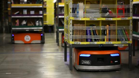 TRACY, CA - JANUARY 20:  Kiva robots move racks of merchandise at an Amazon fulfillment center on January 20, 2015 in Tracy, California. Amazon officially opened its new 1.2 million square foot fulfillment center in Tracy, California that employs more than 1,500 full time workers as well as 3,000 Kiva robots that can fetch merchandise for workers and are capable of lifting up to 750 pounds. Amazon is currently using 15,000 of the robots spread over 10 fulfillment centers across the country.  (Photo by Justin Sullivan/Getty Images)