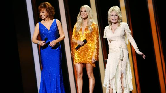 NASHVILLE, TENNESSEE - NOVEMBER 13: (FOR EDITORIAL USE ONLY) (L-R) Reba McEntire, Carrie Underwood, Dolly Parton perform onstage during the 53rd annual CMA Awards at the Music City Center on November 13, 2019 in Nashville, Tennessee. (Photo by Terry Wyatt/Getty Images,)