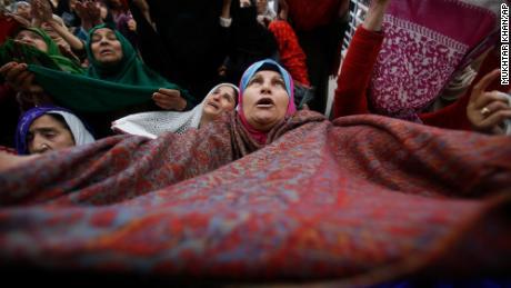 A Kashmiri Muslim woman lifted her veil in the air to pray in Srinagar, India, on November 10. 2019