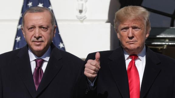 WASHINGTON, DC - NOVEMBER 13: U.S. President Donald Trump (R) gives a thumbs up will greeting Turkish President Recep Tayyip Erdogan upon his arrival at the South Portico of the White House on November 13, 2019 in Washington, DC. The two leaders will meet in the Oval Office before speaking to the media during an East Room joint news conference later in the day.  (Photo by Alex Wong/Getty Images)