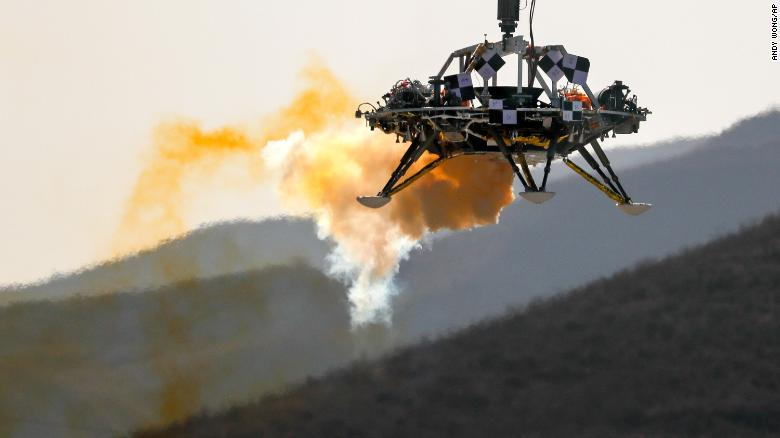 A lander is lifted during testing at a facility in Huailai.
