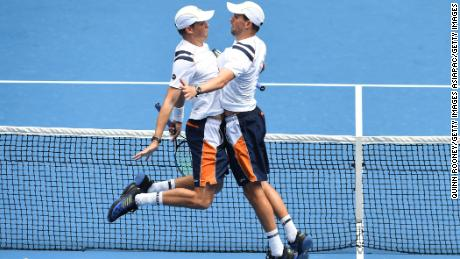 The Bryan brothers perform their trademark chest bump celebration at the 2018 Australian Open.