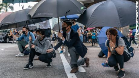 "HONG KONG, CHINA - NOVEMBER 13: Pro-democracy protesters hold umbrellas as during a standoff with police on November 13, 2019 in Hong Kong, China. Anti-government protesters organized a general strike since Monday as demonstrations in Hong Kong stretched into its sixth month with demands for an independent inquiry into police brutality, the retraction of the word ""riot"" to describe the rallies, and genuine universal suffrage. (Photo by Anthony Kwan/Getty Images)"
