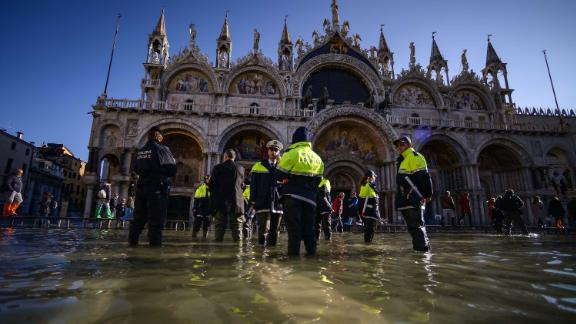 Members of the municipal police stand in water by St. Mark's Basilica on November 14.