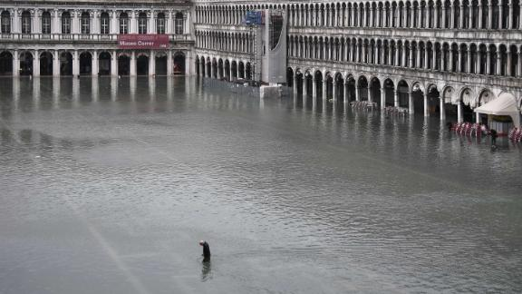 A general view shows a man crossing the flooded St. Mark's Square on November 13.