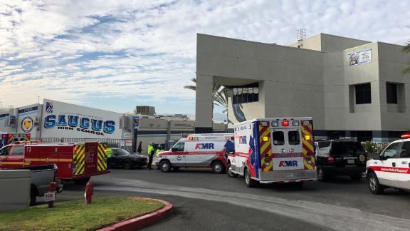 Ambulances are parked outside of Saugus High School after reports of a shooting on Thursday, Nov. 14, 2019 in Santa Clarita, Calif.  A few people were injured Thursday during a shooting at the high school, about 30 miles (48 kilometers) northwest of downtown Los Angeles, and a search was underway for the gunman, authorities said.