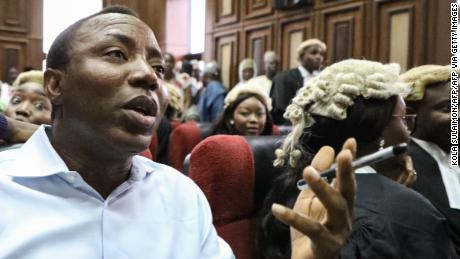 "Convener of ""#Revolution Now"" Omoyele Sowore speaks during his arraignment for charges against the government at the Federal High Court in Abuja, on September 30, 2019. - Nigeria's high court ordered on September 30, 2019,  a former presidential candidate remanded in custody after he was charged with plotting treason over calls for a ""revolution"" in the West African nation. Omoyele Sowore, a fierce critic of President Muhammadu Buhari, has been held since August by the Department of State Services (DSS) secret police after urging protests under the online banner ""#RevolutionNow"". (Photo by KOLA SULAIMON / AFP)        (Photo credit should read KOLA SULAIMON/AFP via Getty Images)"