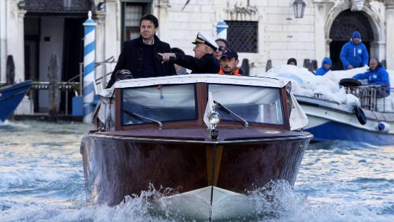 Italian Prime Minister Giuseppe Conte surveys flood damage in Venice on November 14.