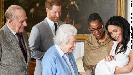 Prince Harry and wife Meghan show their new son Archie Harrison Mountbatten-Windsor to Meghan's mother Doria Ragland, Queen Elizabeth II and Prince Philip, in May last year.