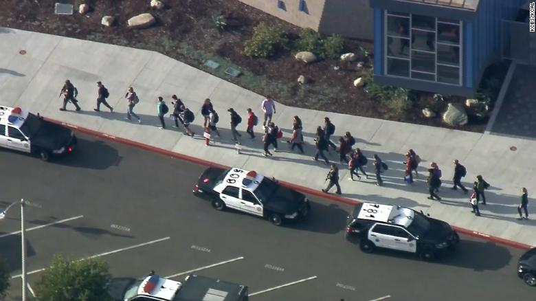 People walk away from the school after the shooting Thursday morning.