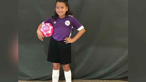 Abigail Moen stands tall in her soccer team uniform.