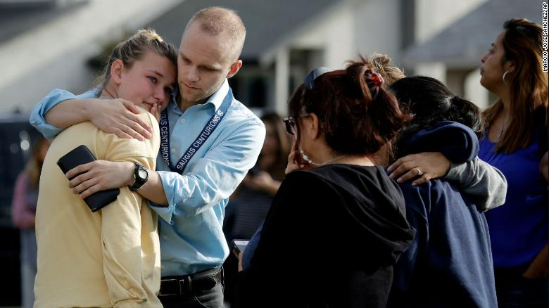 D.J. Hamburger, a teacher at Saugus High School, comforts a student after the shooting.