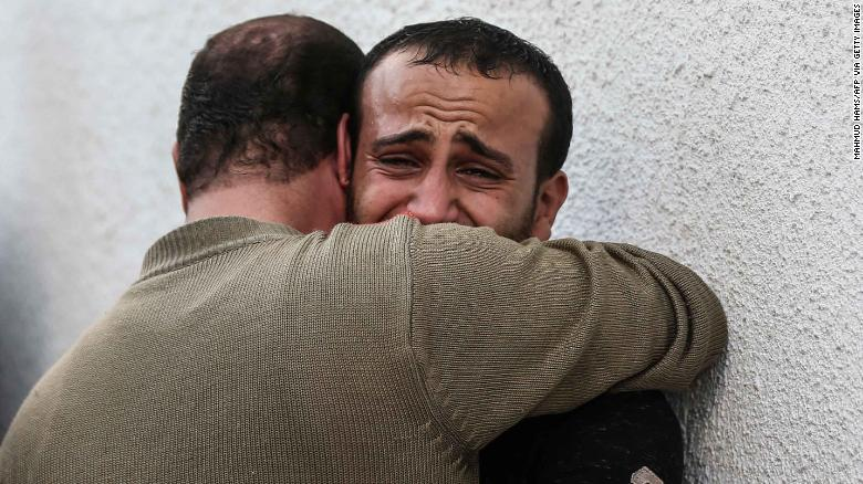 Palestinian men mourn outside the morgue of al-Shifa hospital in Gaza City on Wednesday.