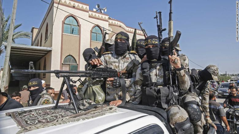 Islamic Jihad militants attend the funeral of a comrade in Khan Younis.