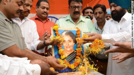 Men pay tribute to former Indian Prime Minister Indira Gandhi, in Amritsar on October 30, 2019