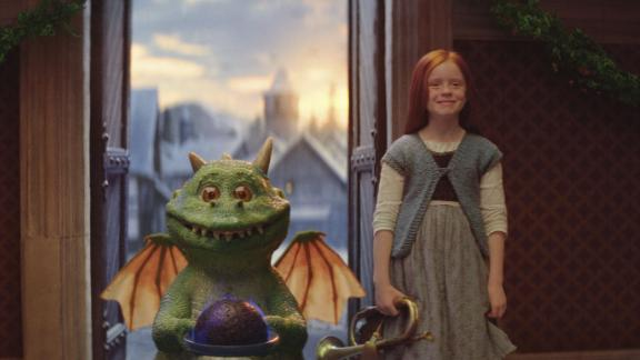 The ad features Edgar the eager dragon and his friend Ava.