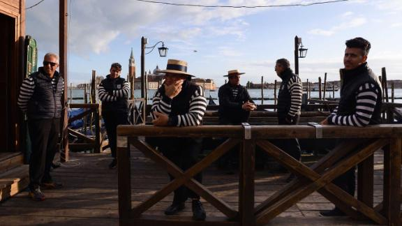 A group of Gondoliers are seen on a pier in Venice, after the city suffered its highest tide in 50 years.