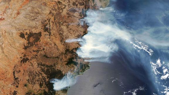 This satellite image shows wildfire smoke on November 14.