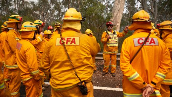 Firefighters organize their crews prior to working on controlled back burns in Sydney on November 14.
