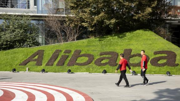 Employees walk through the campus at the Alibaba Group Holding Ltd. headquarters during the annual November 11 Singles