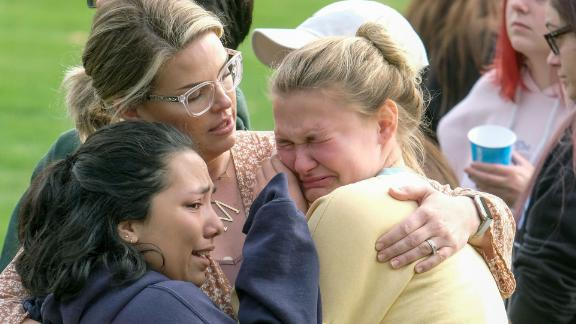 Students are comforted as they wait to be reunited with their parents on Thursday, November 14, following a shooting at Saugus High School in Santa Clarita, California.