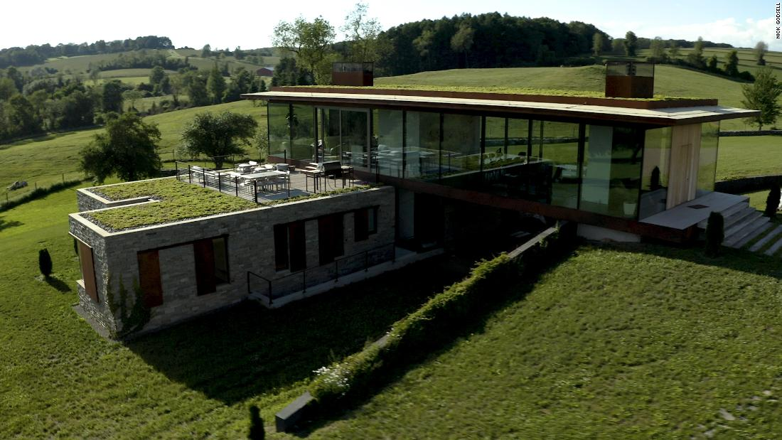 Would you live in a glass house? This family does