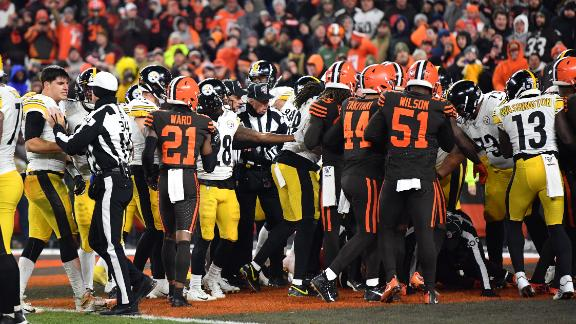 Steelers and Browns fight in the end zone near the end of the game.