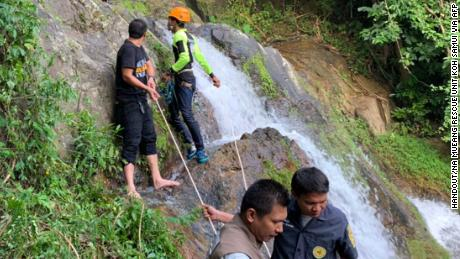 "In this photo released by Na Mueang Rescue Unit, Koh Samui Municipality on November 15, 2019 and taken on November 14, rescuers recover the body of French tourist from a Na Mueang 2 waterfall in Koh Samui island. - A French tourist has died after falling from a waterfall while trying to take a selfie in Thailand, police said November 15. (Photo by Handout / Na Mueang Rescue Unit Koh Samui Municipality / AFP) / -----EDITORS NOTE --- RESTRICTED TO EDITORIAL USE - MANDATORY CREDIT ""AFP PHOTO / Na Mueang Rescue Unit Koh Samui Municipality"" - NO MARKETING - NO ADVERTISING CAMPAIGNS - DISTRIBUTED AS A SERVICE TO CLIENTS - NO ARCHIVE (Photo by HANDOUT/Na Mueang Rescue Unit Koh Samui /AFP via Getty Images)"