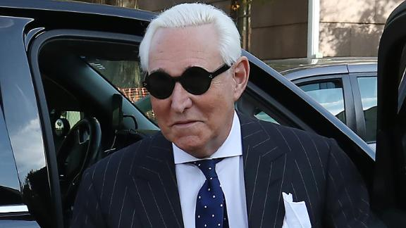 Roger Stone, former adviser to President Donald Trump, holds a bible as he arrives at the E. Barrett Prettyman United States Courthouse, on November 15, 2019 in Washington, DC.
