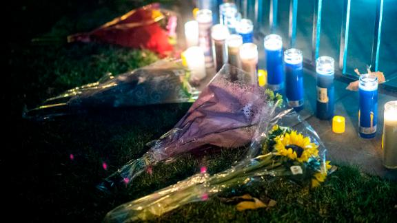 People affected by the Saugus High School shooting leave candles and flowers during a vigil at Central Park in Santa Clarita.
