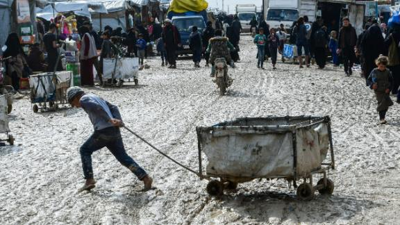 A boy pulls a cart in al-Hol camp which houses thousands of relatives of ISIS group members in northeastern Syria.