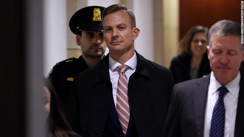 David Holmes, a State Department official, arrives Friday afternoon for a closed-door deposition hearing as part of the impeachment inquiry at the US Capitol in Washington, DC.
