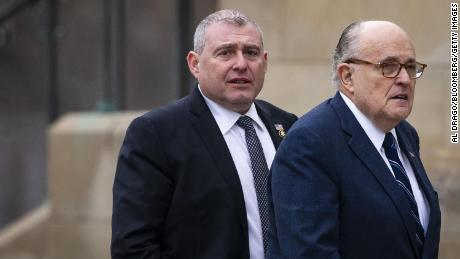 Rudy Giuliani, former mayor of New York, arrives with his associate Lev Parnas, left, before a state funeral service for former President George H.W. Bush at the National Cathedral in Washington, on Wednesday, December 5, 2018.