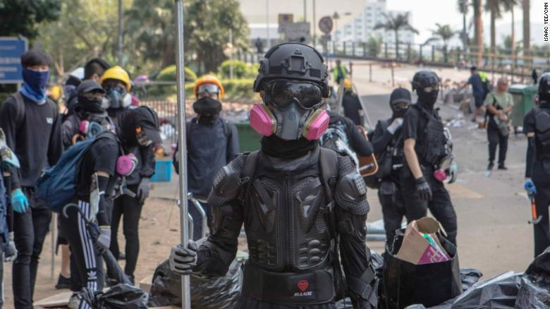 Protesters stand guard at the entrance to Hong Kong Polytechnic University (PolyU) on November 15, 2019.