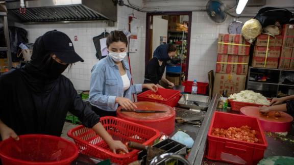 People prepare food for protesters at Hong Kong Polytechnic University (PolyU) on November 15, 2019.
