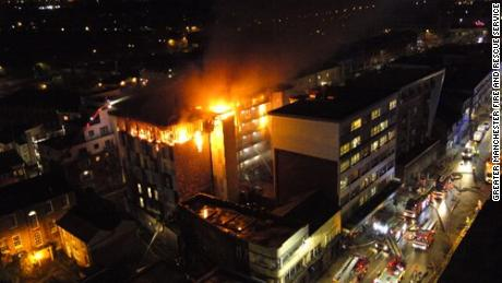 Two people were injured in the blaze, which engulfed student flats in Bolton, England.