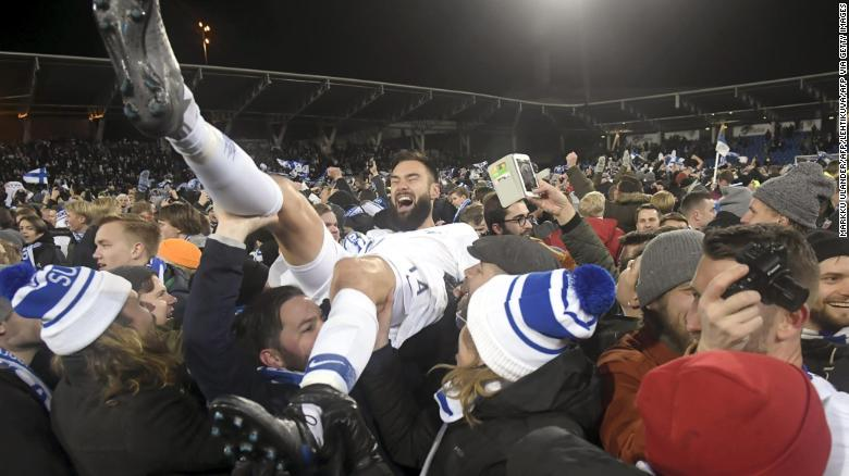 Finnish captain Tim Sparv is carried aloft by fans after the historic win in Helsinki.