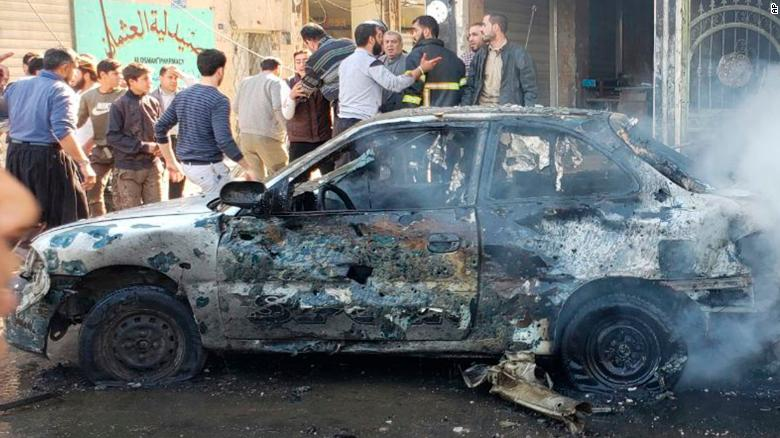 This photo provided by the Syrian anti-government activist group Albab City, which has been authenticated based on its contents and other AP reporting, people check the aftermath of a car bomb exploded in the city of al-Bab, northern Syria, Saturday, Nov. 16, 2019. A car bomb exploded Saturday in a northern Syrian town controlled by Turkey-backed opposition fighters, killing at least 18 people and wounding several others, Syrian opposition activists and Turkey's Defense Ministry said. (Albab City via AP)