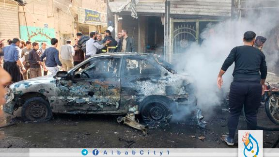 This photo provided by the Syrian anti-government activist group Albab City, which has been authenticated based on its contents and other AP reporting, people check the aftermath of a car bomb exploded in the city of al-Bab, northern Syria, Saturday, Nov. 16, 2019. A car bomb exploded Saturday in a northern Syrian town controlled by Turkey-backed opposition fighters, killing at least 18 people and wounding several others, Syrian opposition activists and Turkey