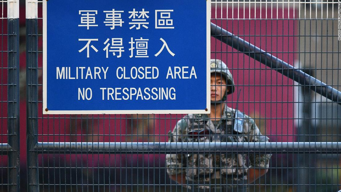 A member of China's People's Liberation Army (PLA) stands guard inside Osborn Barracks in Kowloon Tong in Hong Kong on November 16, 2019.