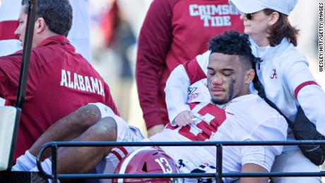 Alabama quarterback Tua Tagovailoa is carted off the field after suffering a dislocated hip against Mississippi State on Saturday, November 16, 2019.