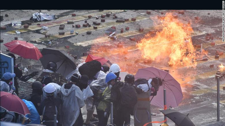 Image result for Hong Kong protesters set fire to entrance of fortified university to hold back police