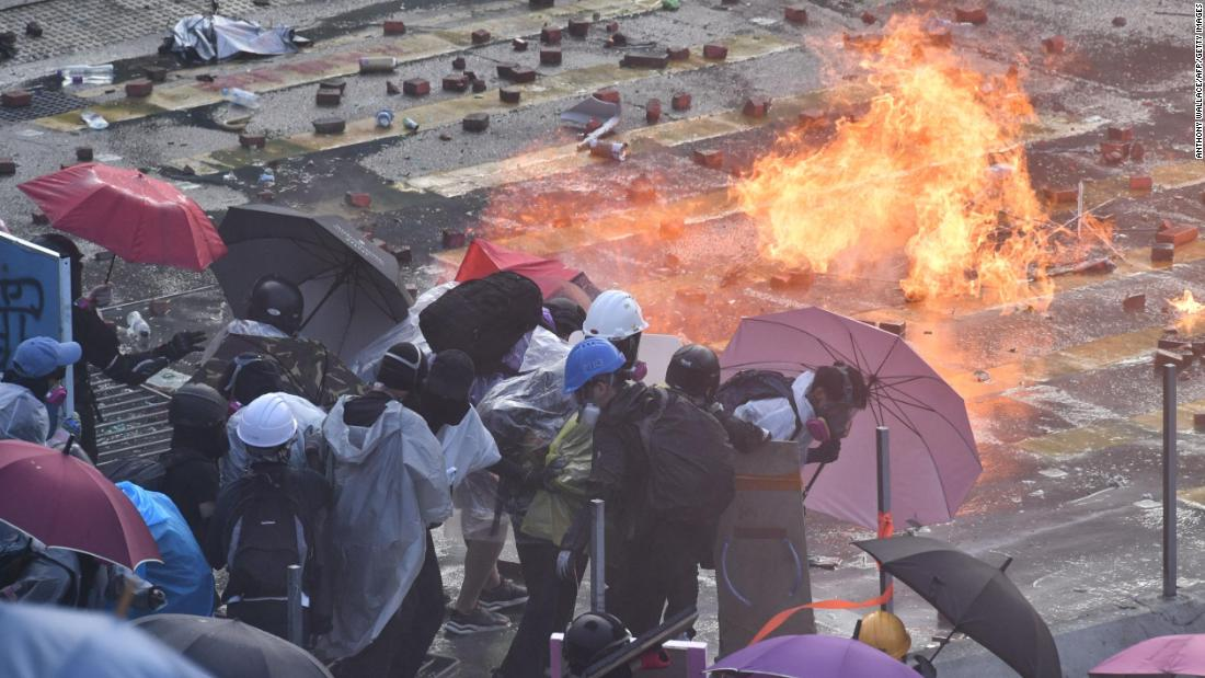 Hong Kong protesters set fire to entrance of fortified university to hold back police