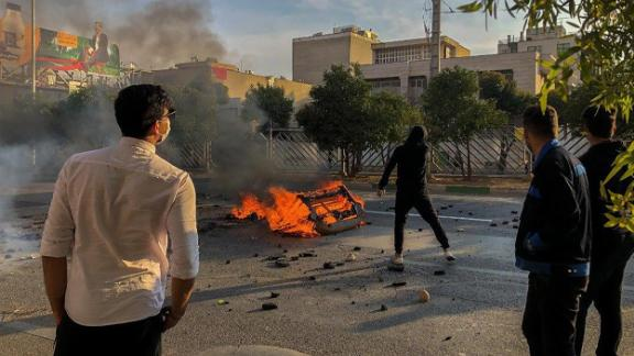 Iranian protesters block a road during a demonstration against an increase in gasoline prices in the central city of Shiraz on Saturday.