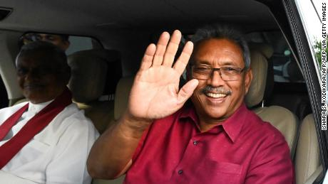 Sri Lanka's President-elect Gotabaya Rajapaksa waves at supporters as he leaves the election commission office in Colombo on November 17, 2019.